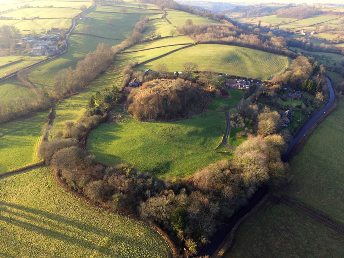 Aerial view of Ewyas Harold near the Herefordshire boundary. William fitzOsbern's motte is plain to see, ringed as it is by a 'curtain' of trees