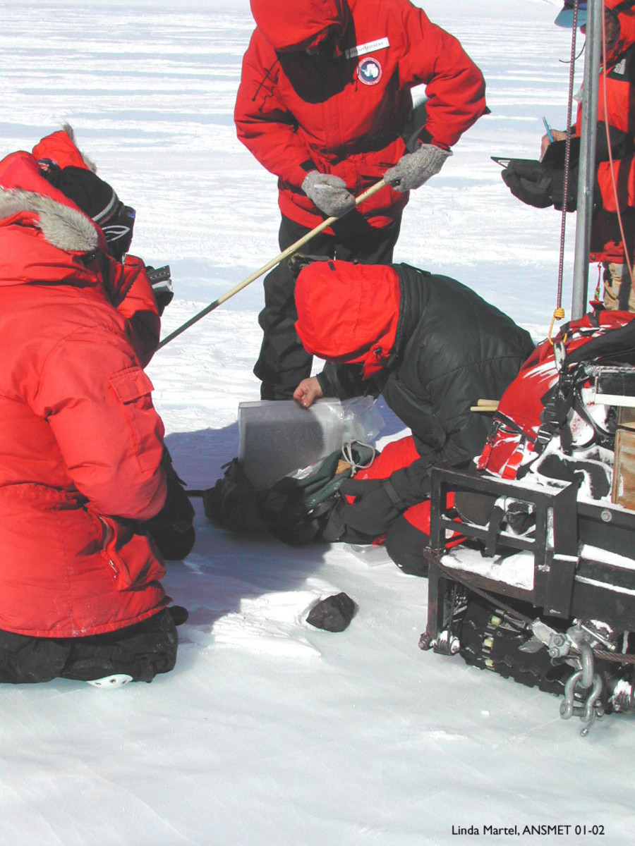 Recovery of a meteorite in Antarctica by members of the U.S. Antarctic Search team recovering meteorite in Antartica, this photo was taken in 2001