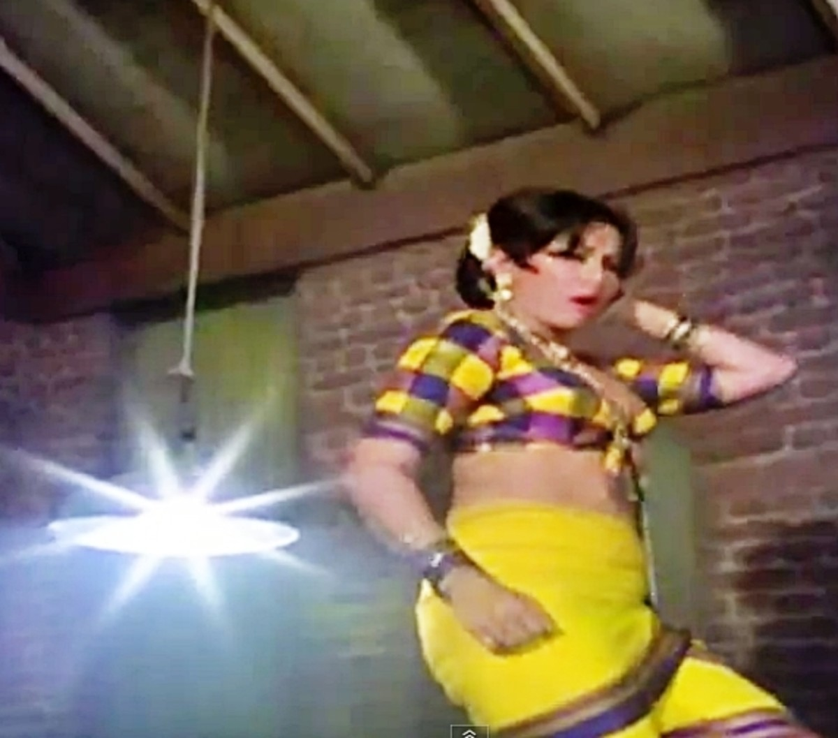 Another sensuous Item Number from Helen: A titillating Folk Dance with unconventional lyrics
