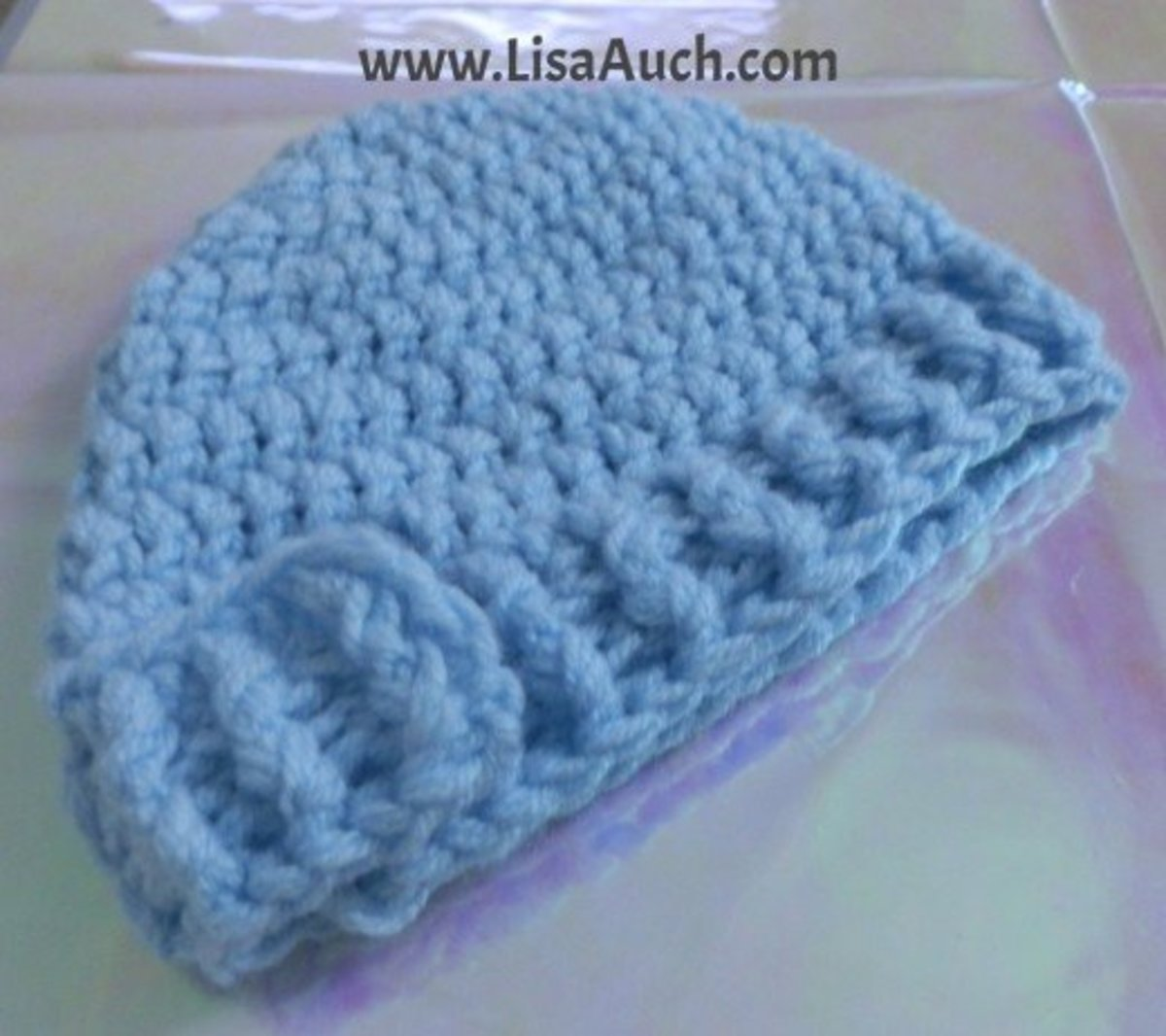 Beanie finished with a simple front post back post double crochet rib.