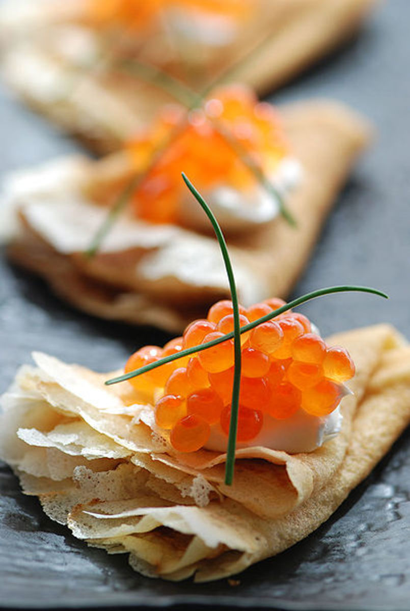 A popular Russian dish - blinis (crapes) with red caviar