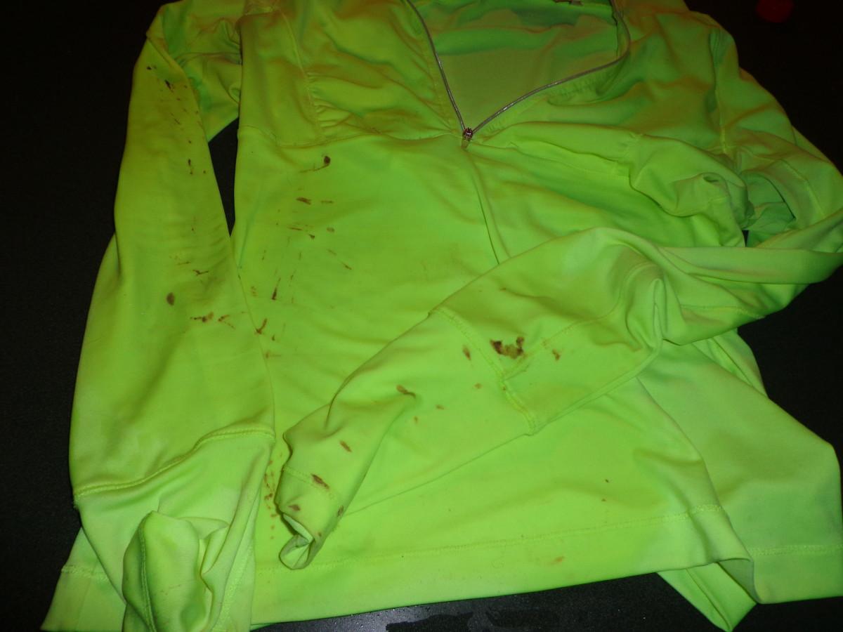 Muddy running shirt made from moisture-wicking material.