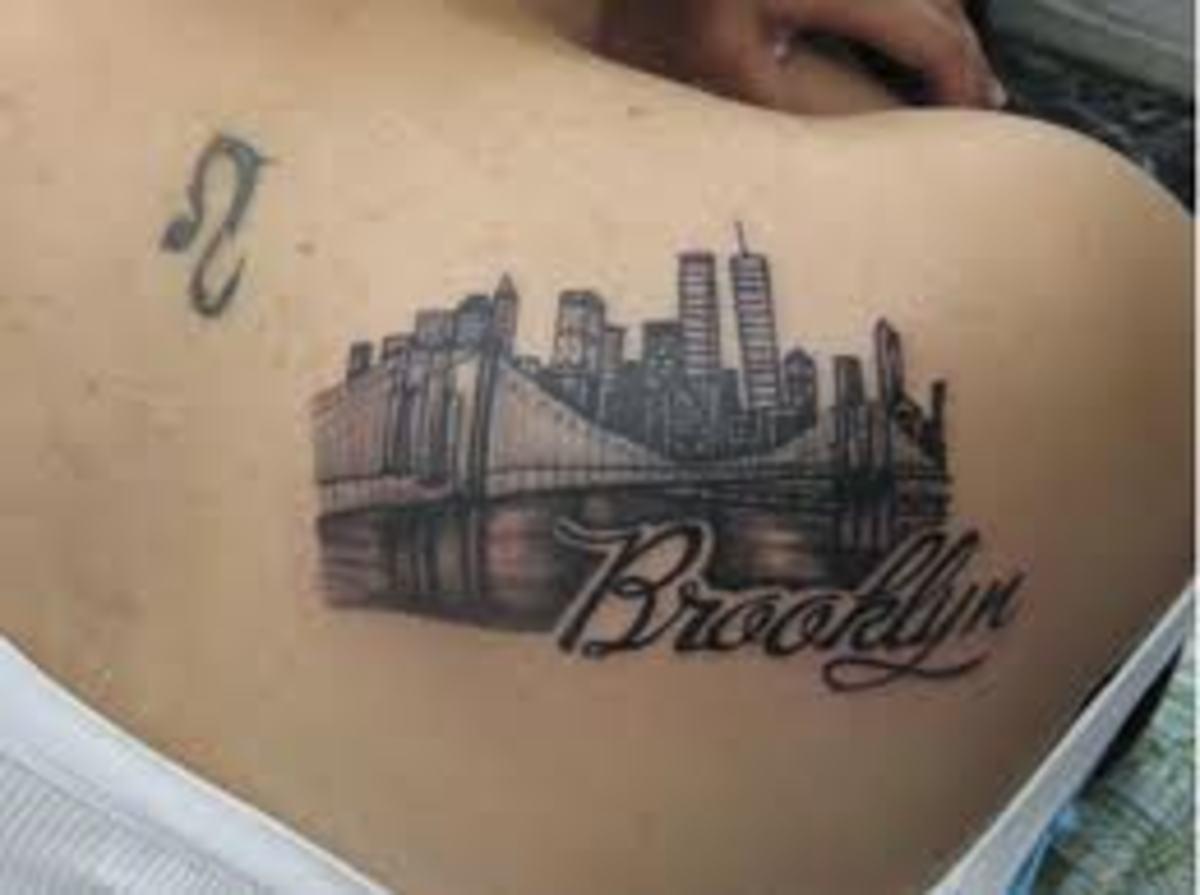 bridge-tattoos-and-meanings-bridge-tattoo-ideas-and-bridge-tattoo-designs