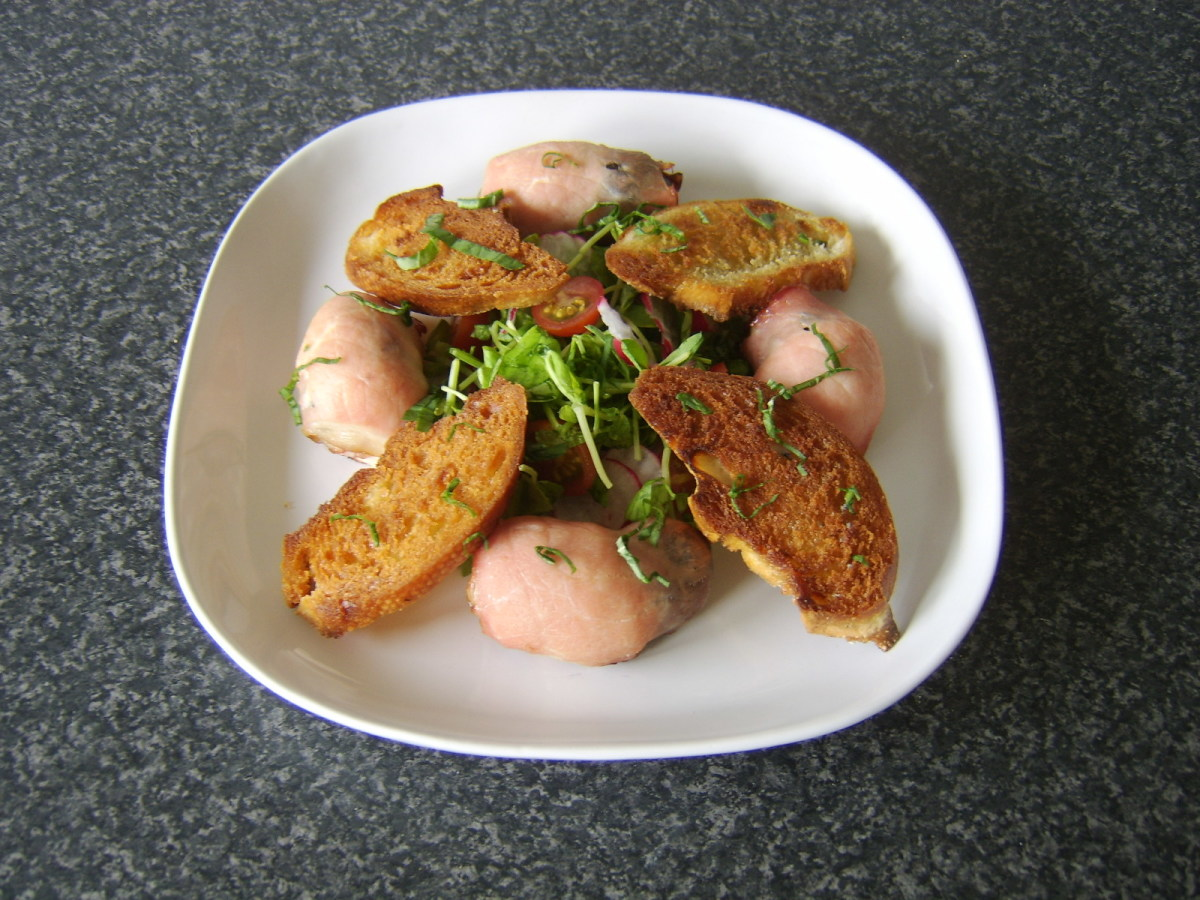 Chicken devils on horseback with pea shoots and radish salad, croutons and basil garnish