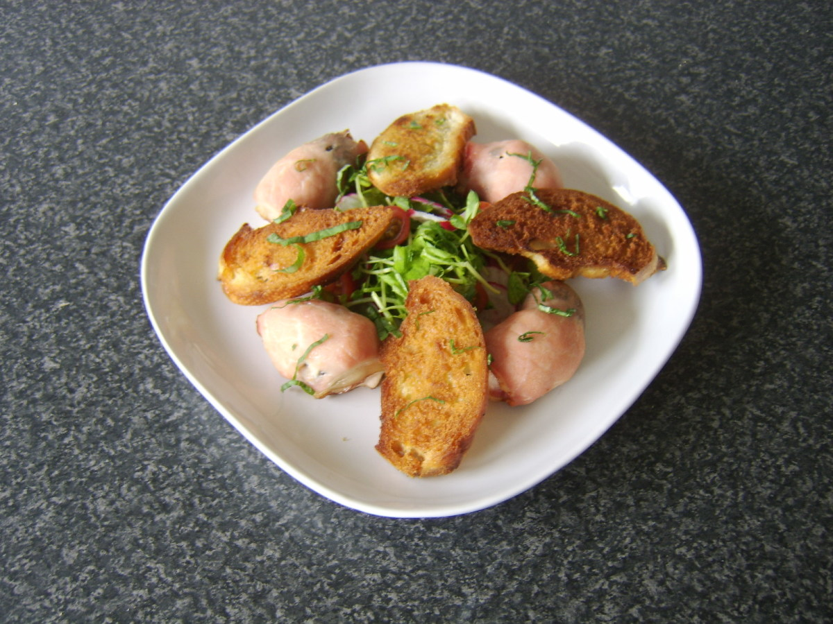 Dried prunes and chicken breast are rolled in bacon and baked, before being served with a pea shoot and radish salad and homemade croutons