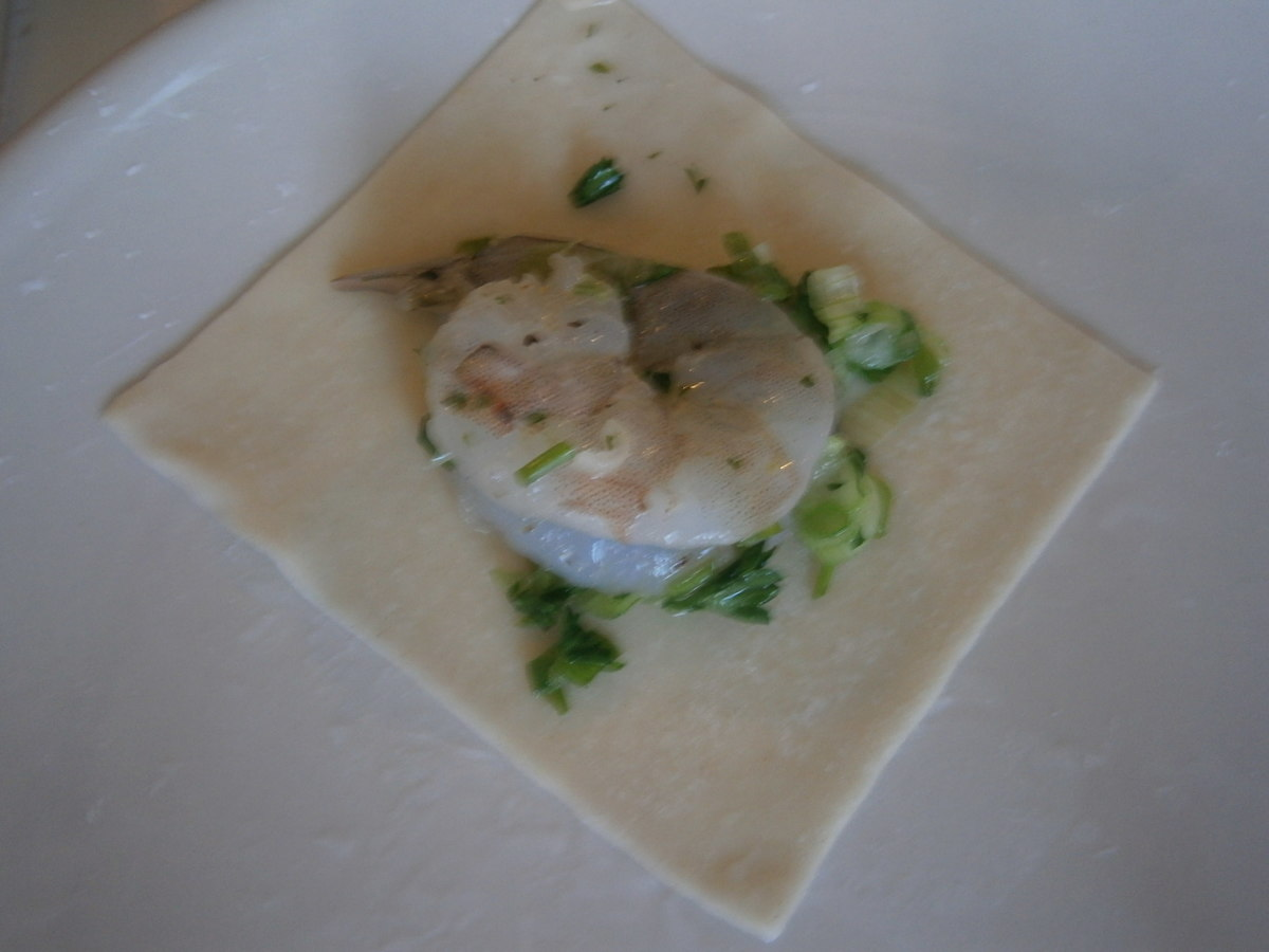 Place shrimp in the middle of wanton wrapper.