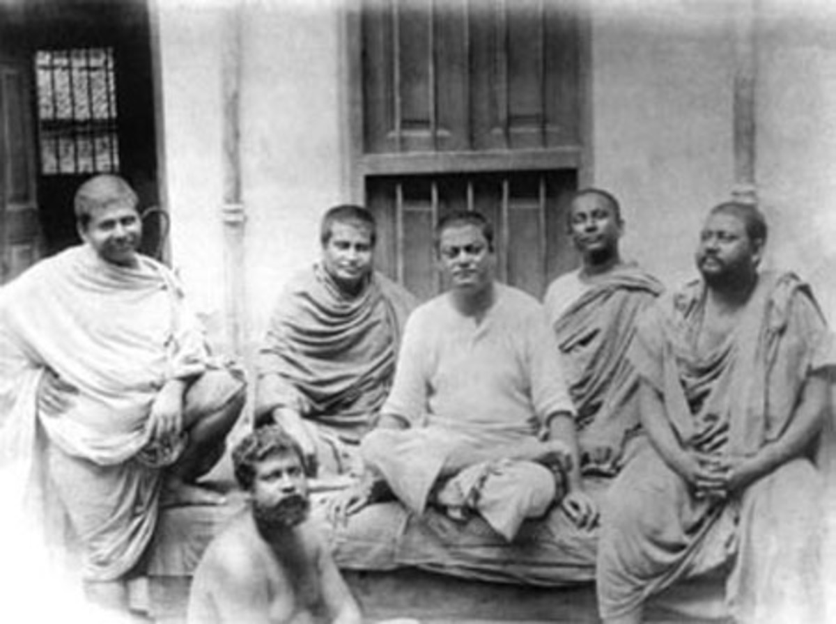 The monastic disciples of Ramakrishna Paramahamsa taken in 1899. Seated in the center is Naren, the future Swami Vivekananda. To the reader's extreme right is Swami Brahmananda.