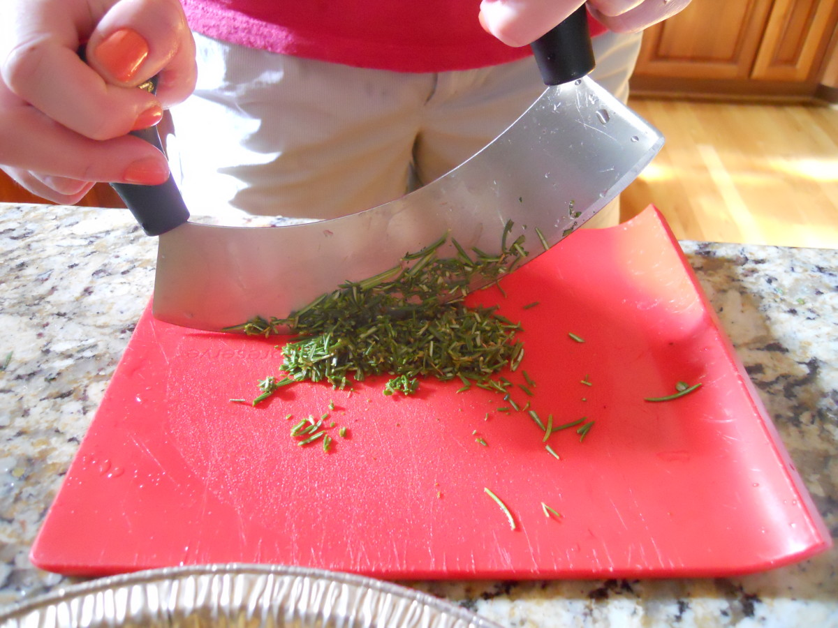 use a single mezzaluna to cut herbs with ease