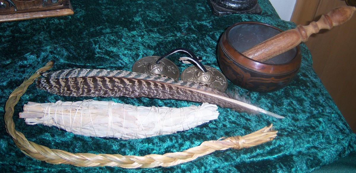 From the bottom up - Sweetgrass White sage stick Hawk feather Chimes Tibetan Singing Bowl