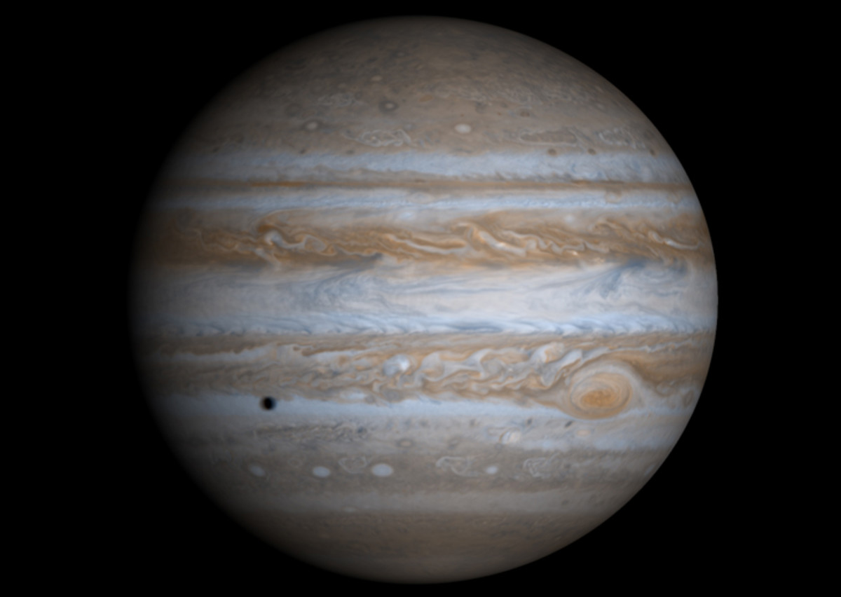 This image is composed of four separate images taken by the Cassini spacecraft in order to offer a full-field view. The dark spot on Jupiter's surface is the shadow of the moon Europa.