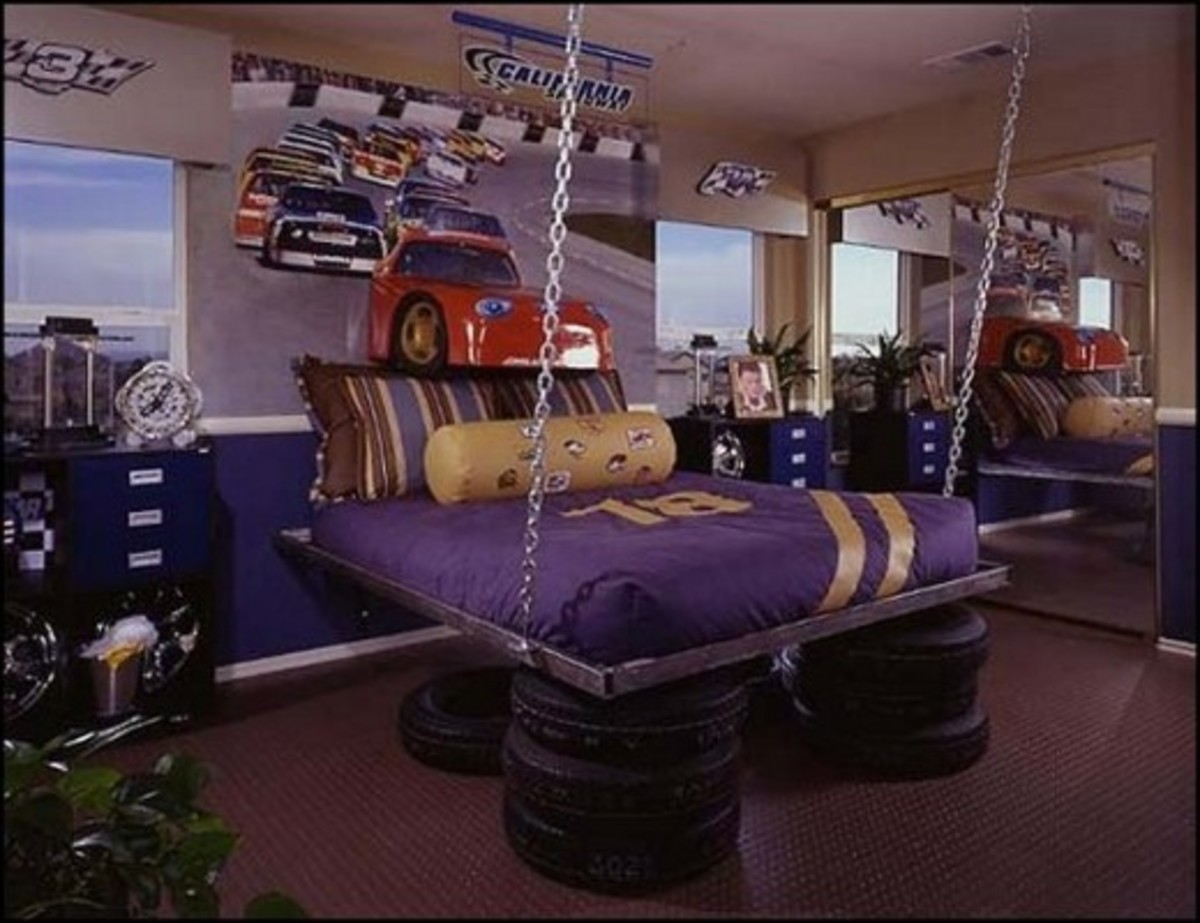 With actual tires under the bed & a car popping out of the wall this room looks amazing! That bed is pretty wild too.