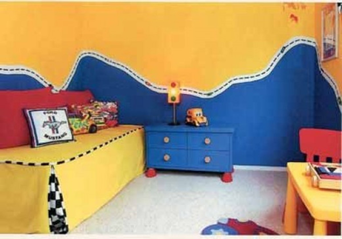 This room is pretty simple on the theme with lots of bright colors that can be reused when the child switches interests. The walls are amazing though!