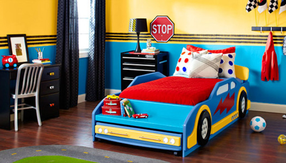 That bed makes the entire room! By matching the colors of the bed to the wall the room feels totally tied together.