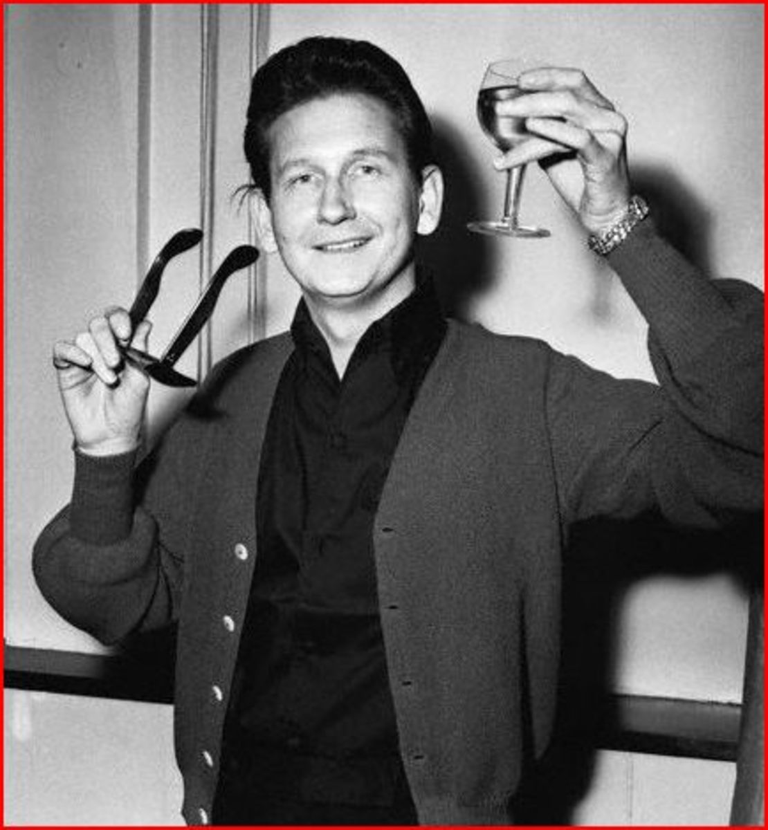 Roy Orbison wore his glasses of necessity, marketing, and shyness. The shyness is only on stage though.