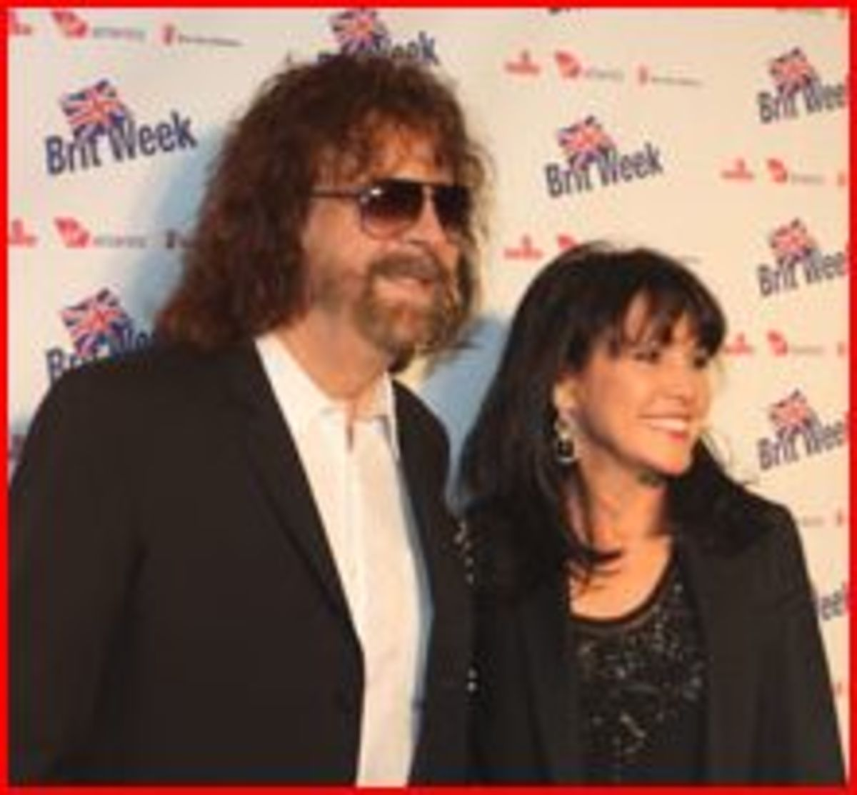 Here he is at an evening charity bash with his lovely wife.