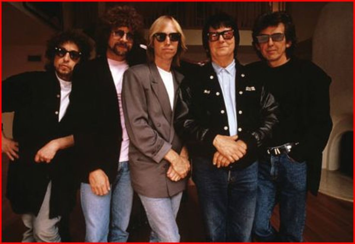 3 of the 5 Traveling Wilburys are able to shed their sunglasses.