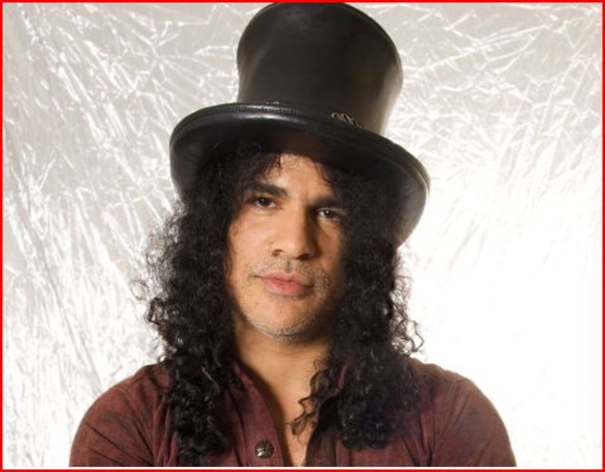 Slash without his glasses looks like a person getting a mugshot. The hat helps only a little bit.