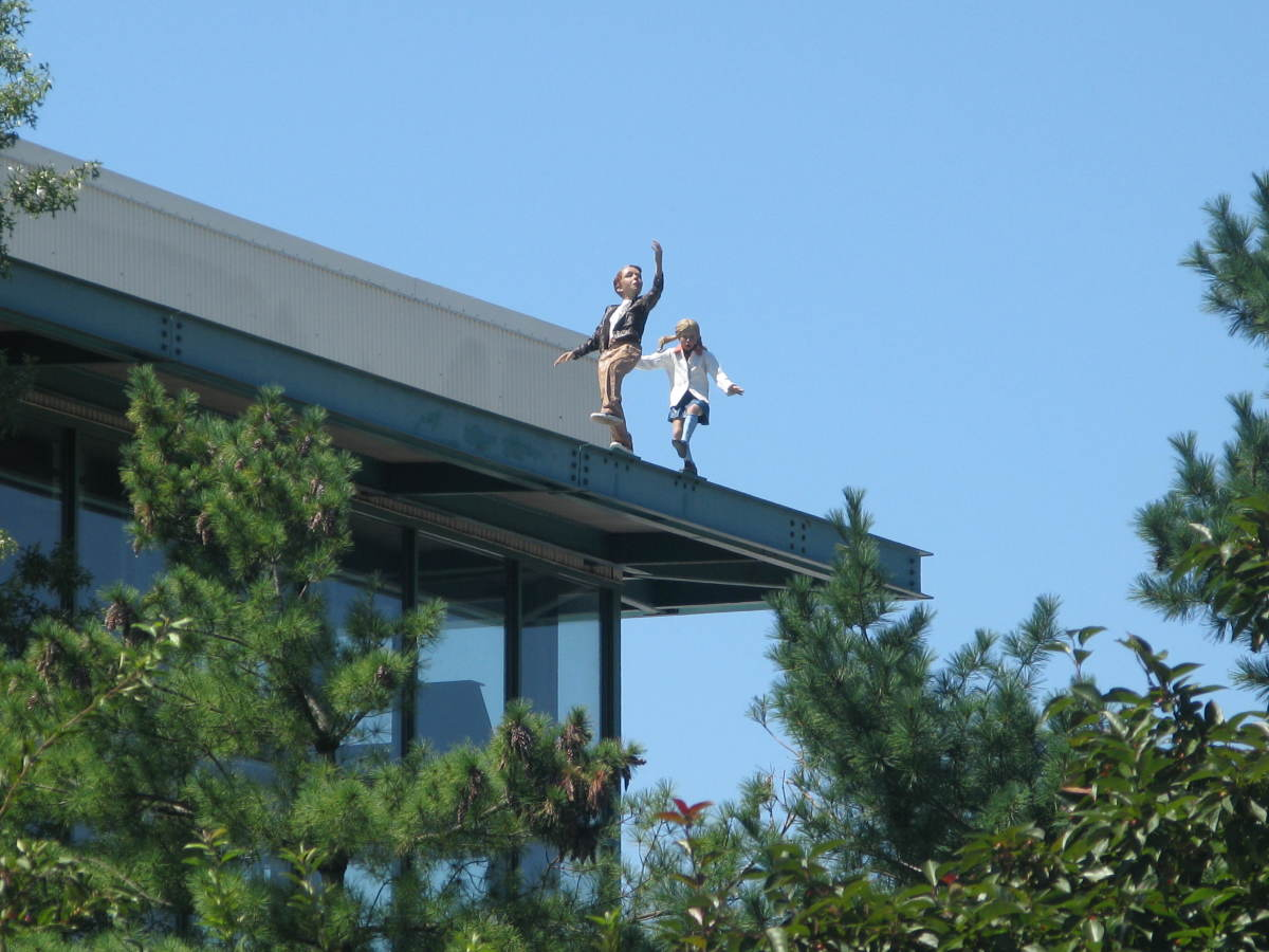 The sculptures appear all over the park, even on top of buildings.