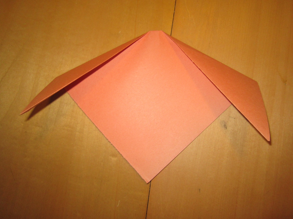 Fold corners down for ears.