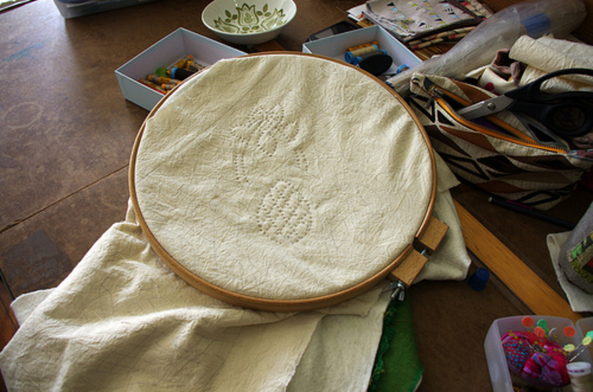 Using a quilting hoop helps keep your stitches even.