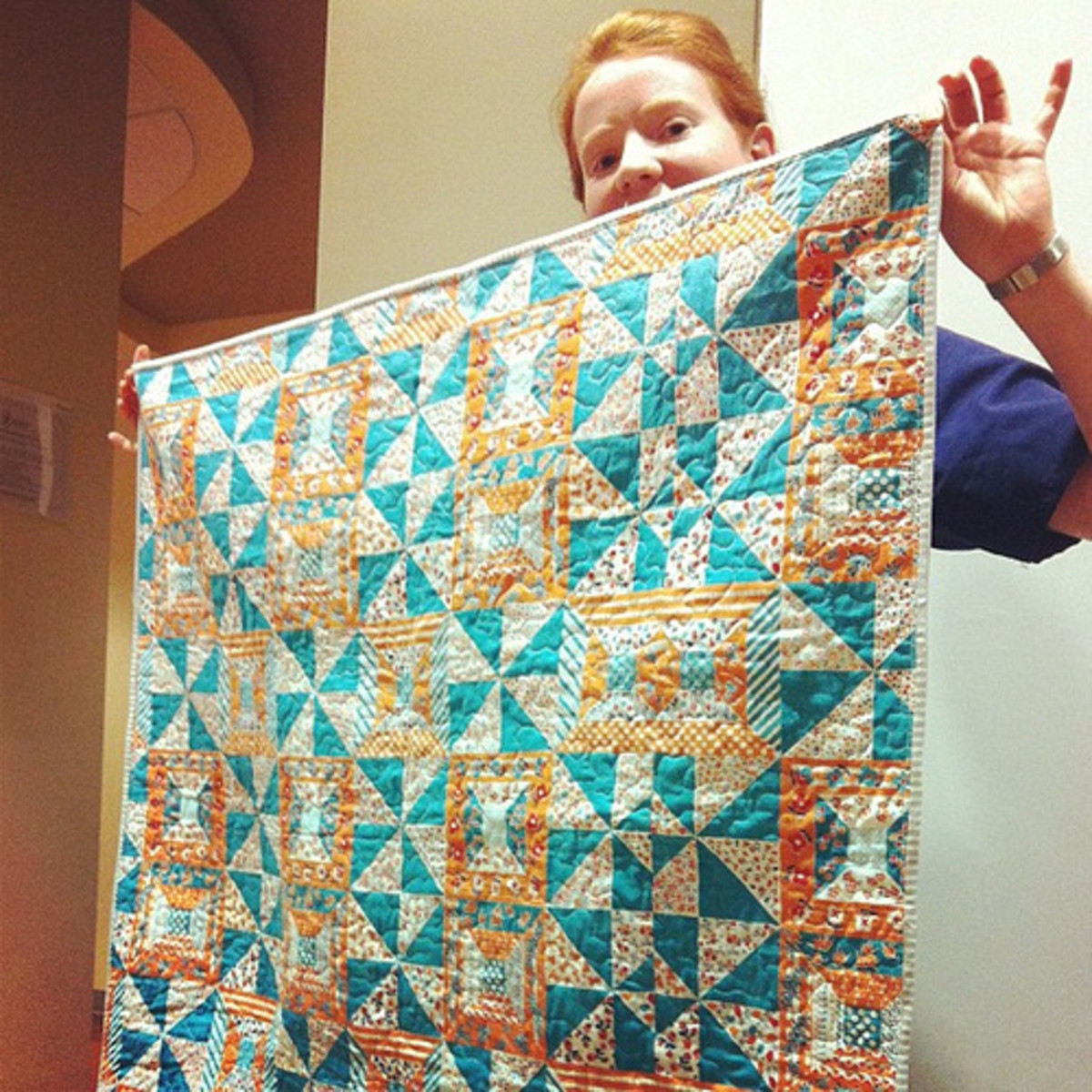 This quilt looks like it is pieced, but it is actually made from a fantastic vintage cheater cloth.
