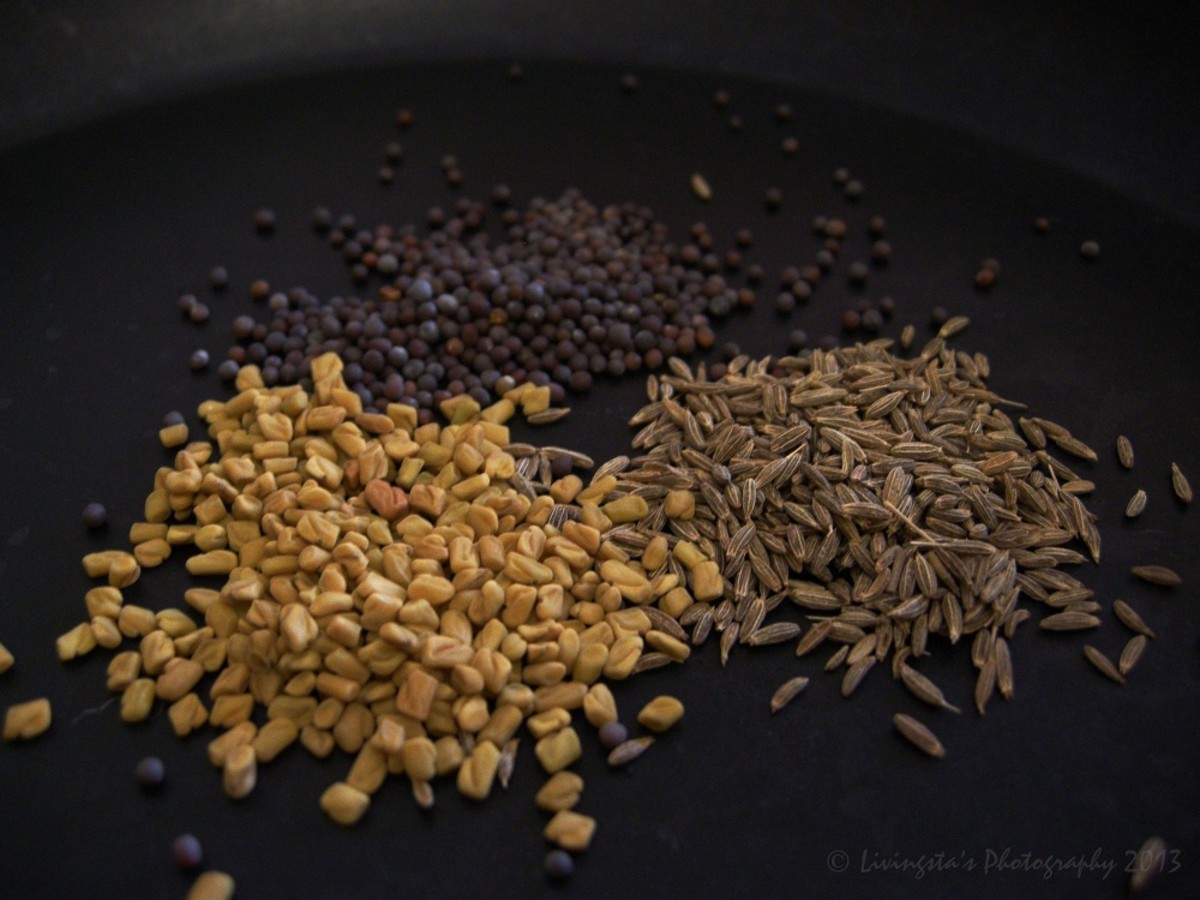 Clockwise from bottom left: Fenugreek seeds, Mustard seeds, Cumin seeds