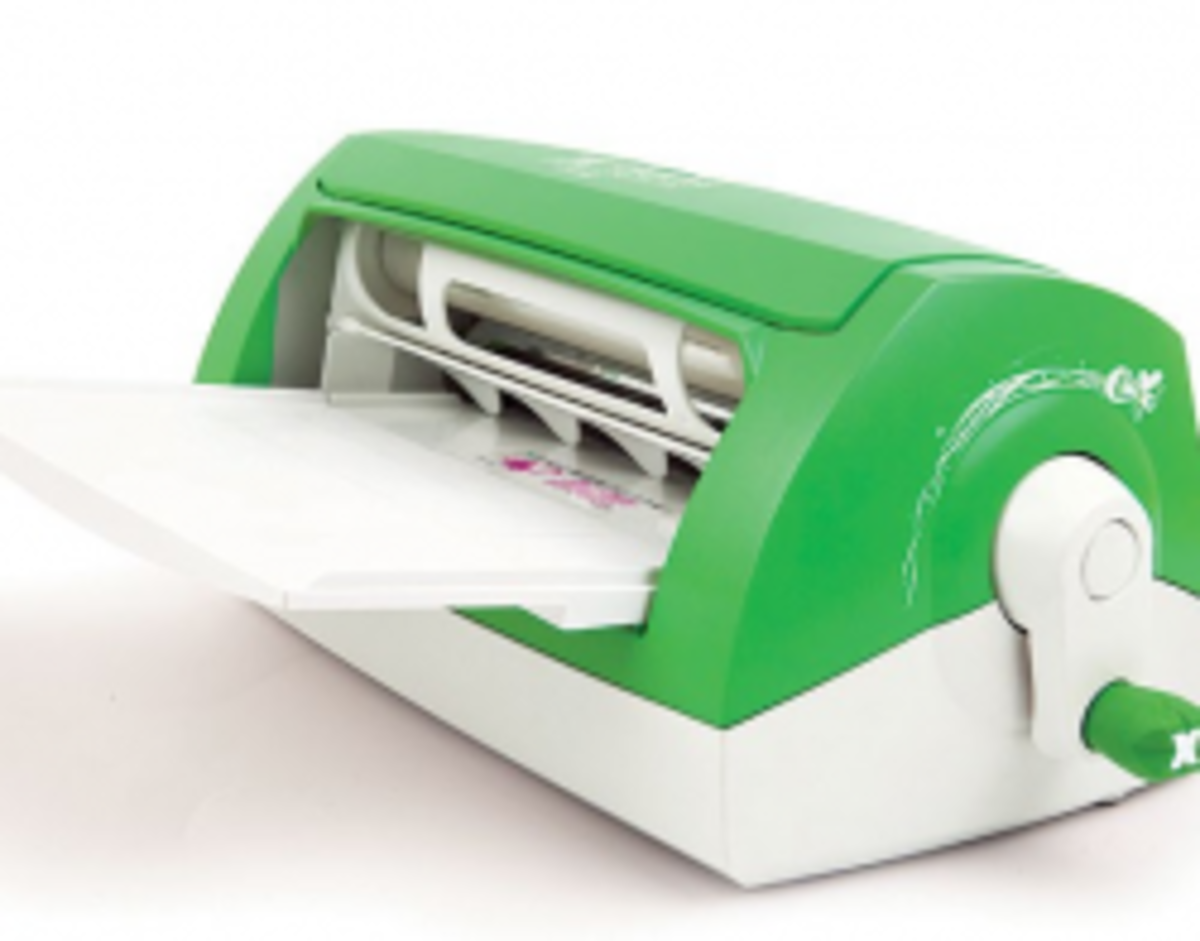 The Xyron machine adds adhesive to card stock projects