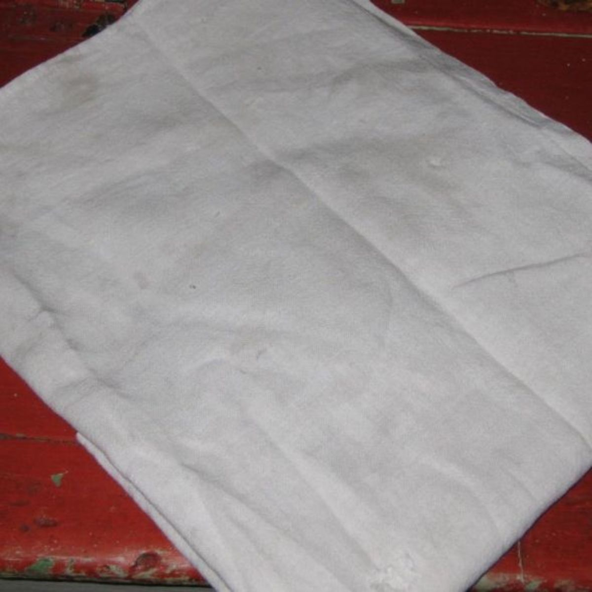 White cotton fabric with small holes.