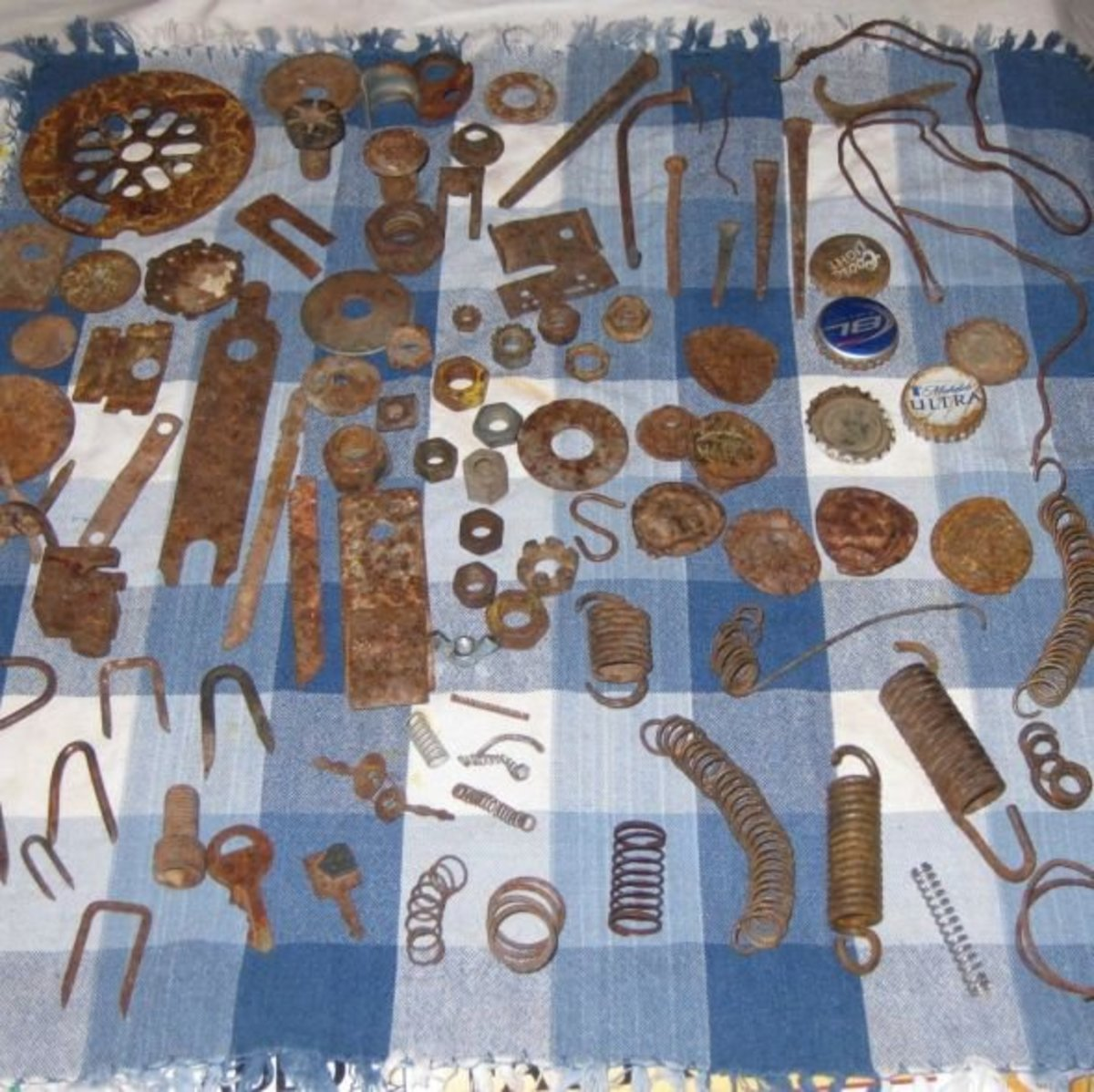 An assortment of rusty junk for rust dyeing.