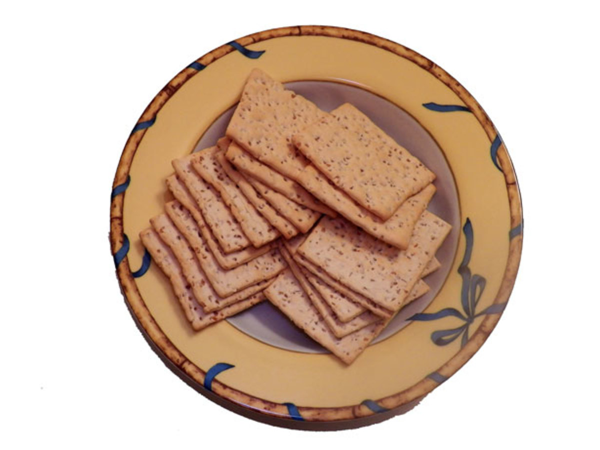 """What's in those crackers? Back to Nature, Larabar, Tostitos Organic, Kashi and """"O"""" Organics all spent money to avoid mandatory GM labeling."""