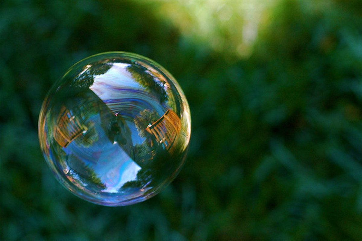 Full of life, vibrancy, and color, a bubble transitions quickly before disappearing into thin air.