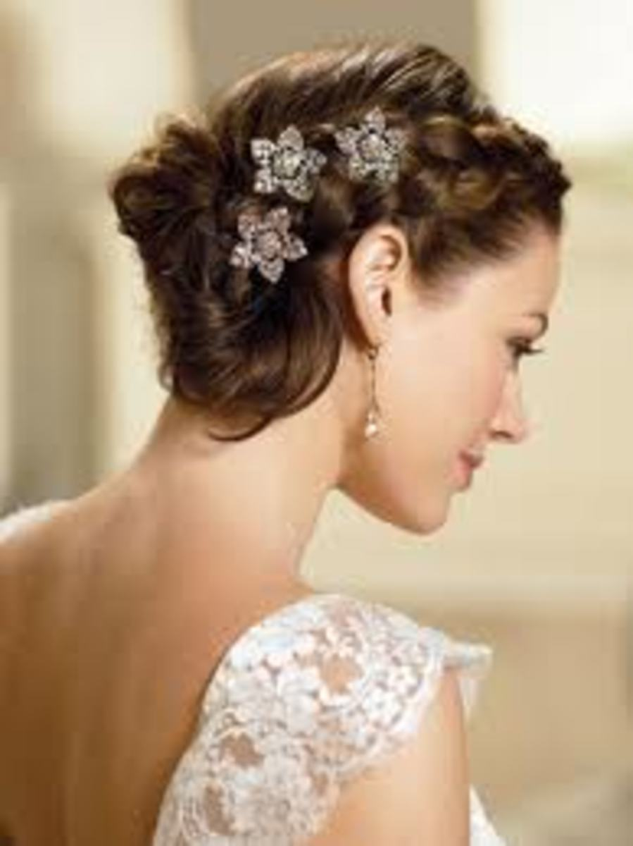 Classy Updo Hairstyles for Brides with Veils and Tiaras