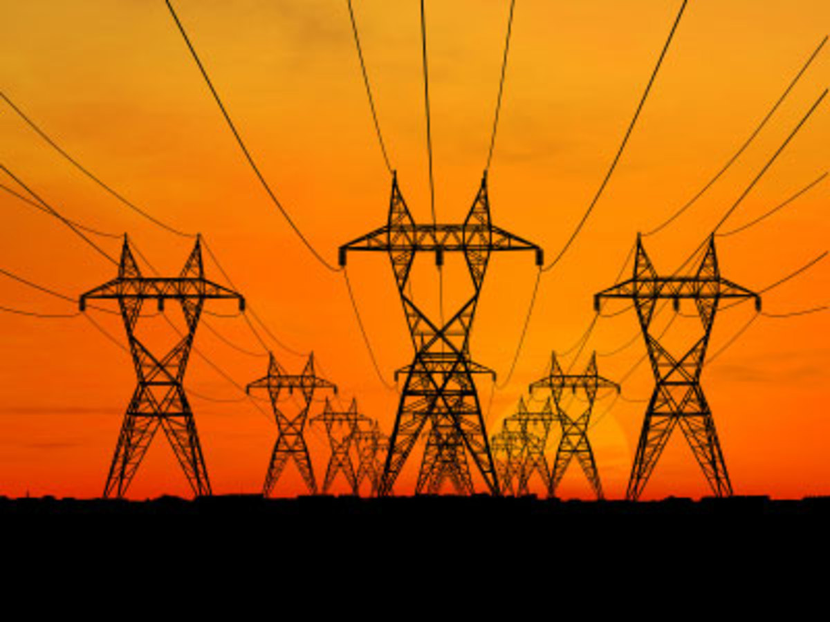 High voltage electrical lines such as these transmit alternating current from generating stations to consumers nationwide.