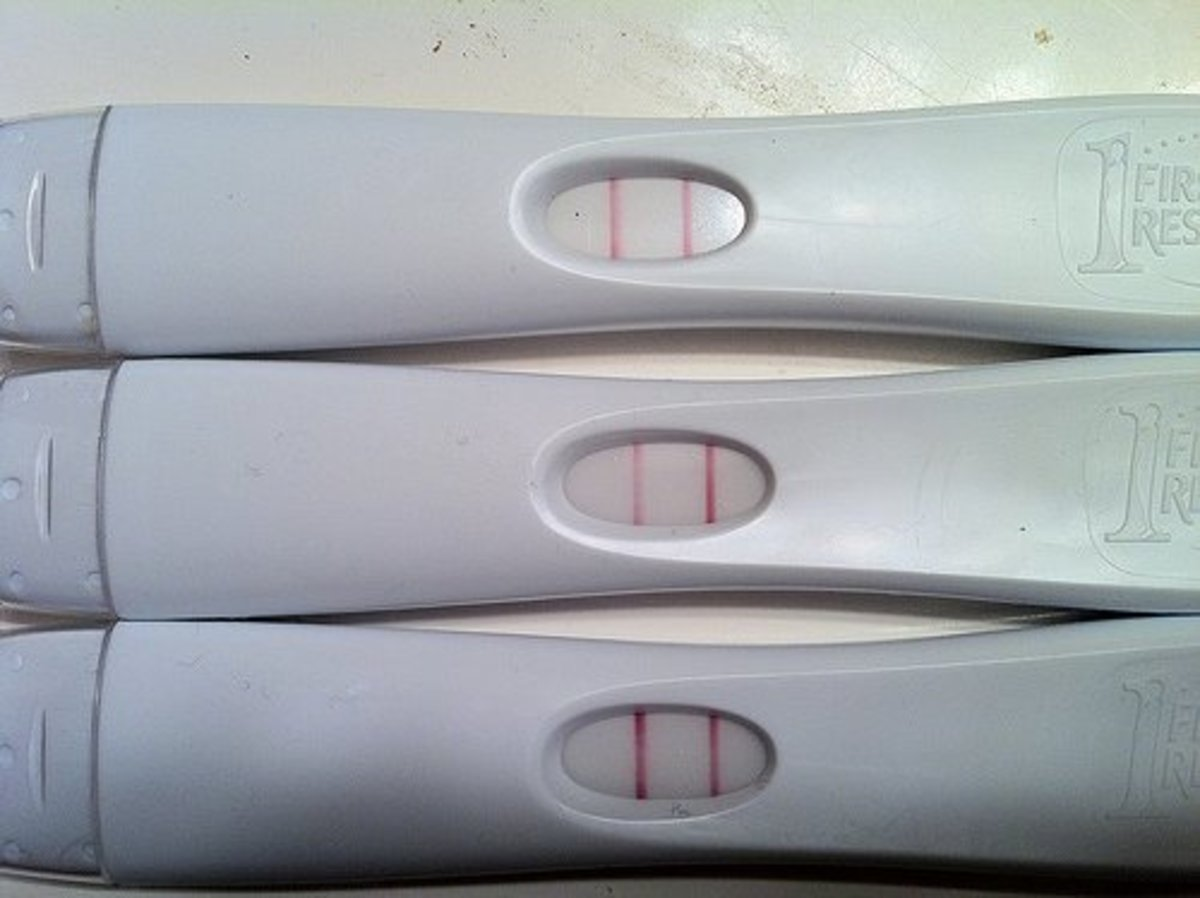The bottom is demonstrating a positive ovulation test.