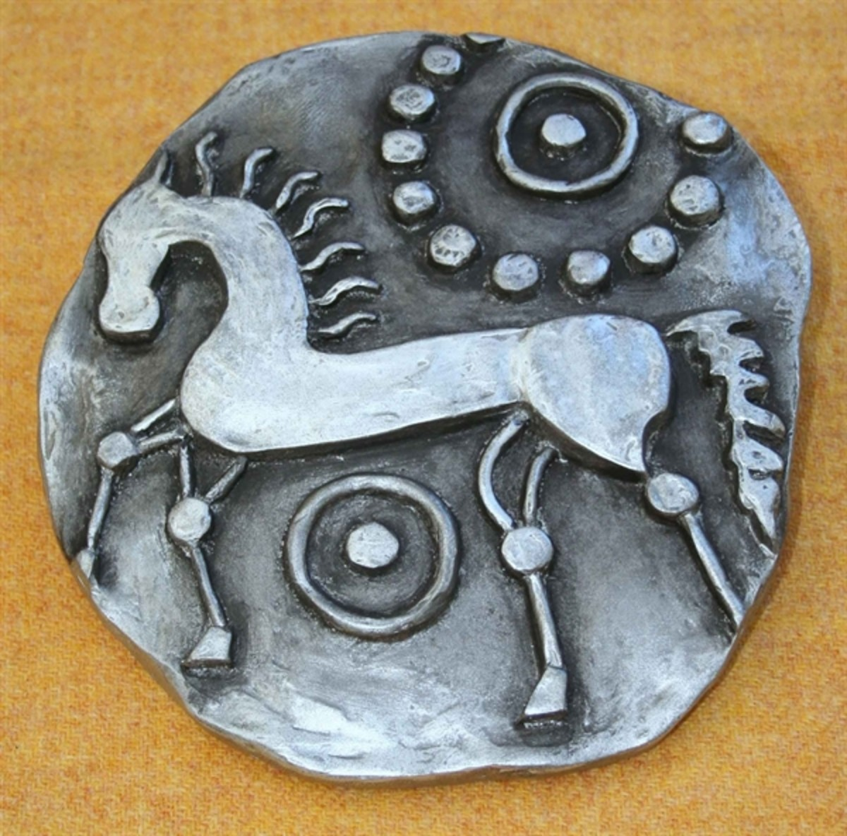 Celtic horse coin design from an original - note the 'sun' circle design above the horse's back, another aspect of Celtic worship