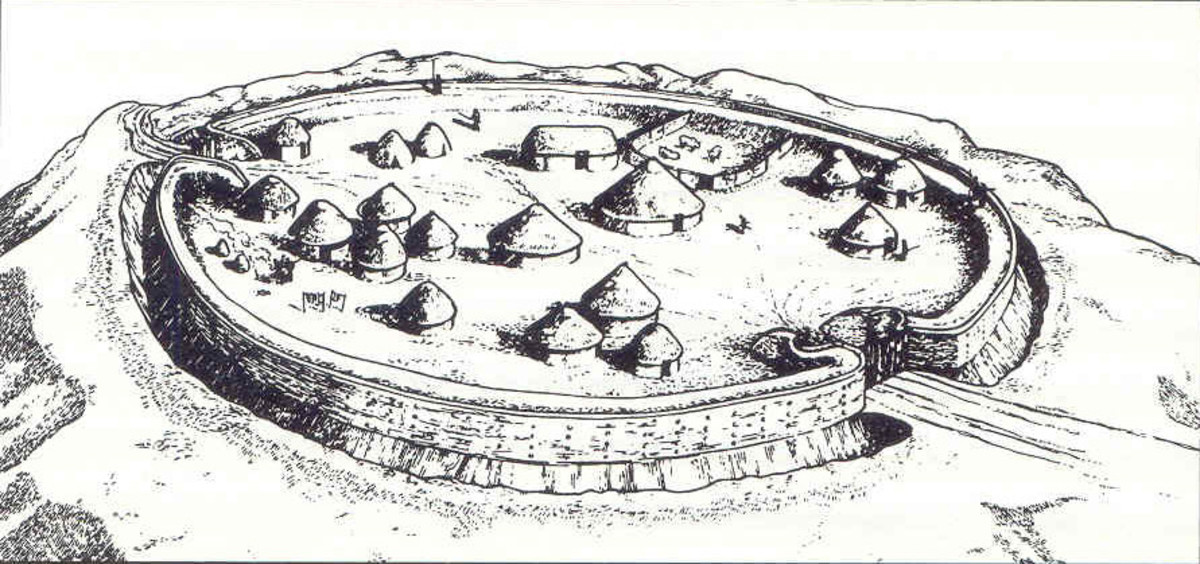Drawing of a Celtic hill fort showing the round houses within the stockade and very solid-looking gateway