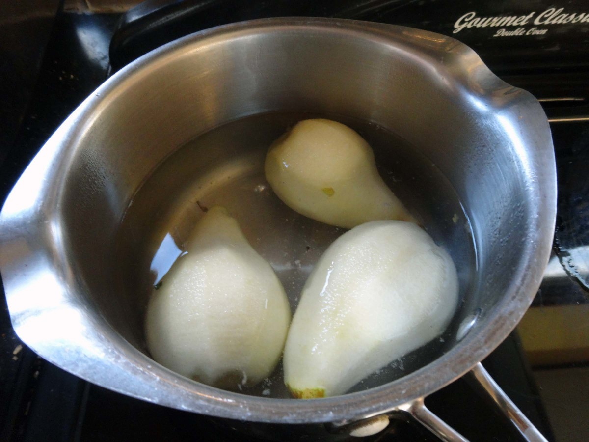 Pears gently simmered in water until cooked with a few drops of vanilla essence and sugar.