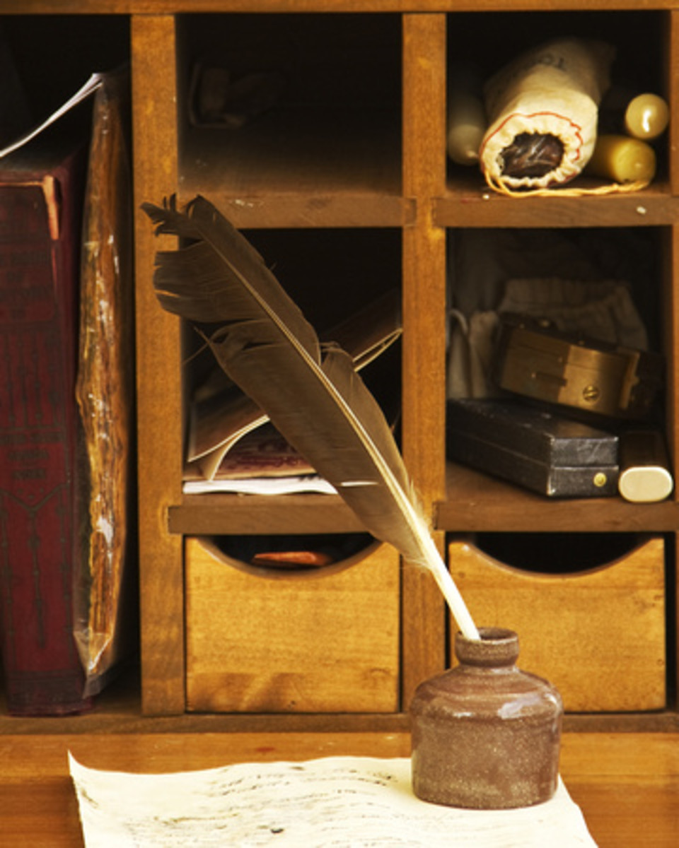 A quill and inkwell. Though this desk setting was either for an officer or in a home, the quill and inkwell are accurate for a common infantryman's writing tools.
