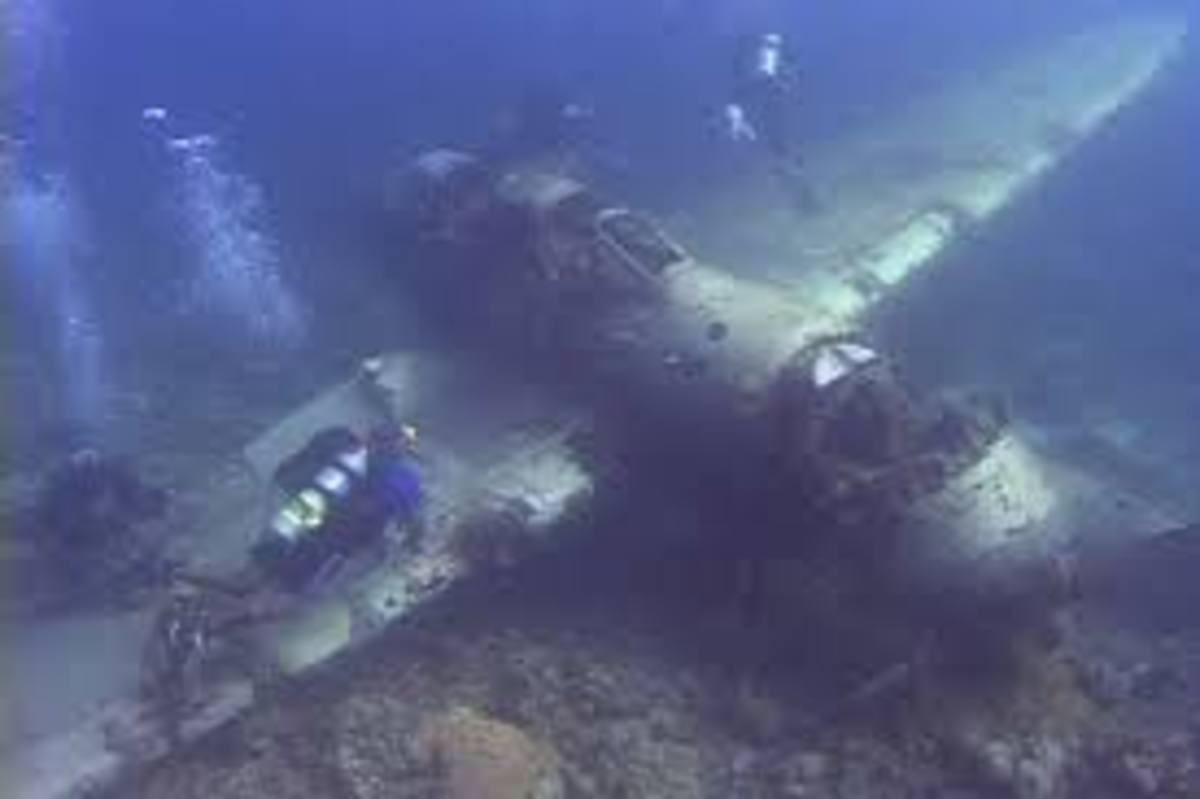 military-warship-tank-airplane-graveyard-under-the-sea-sunken-wwii-hardware