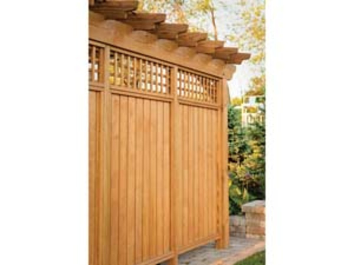 rustic wood unpainted cedar wood privacy fence with a pergola as the top design element