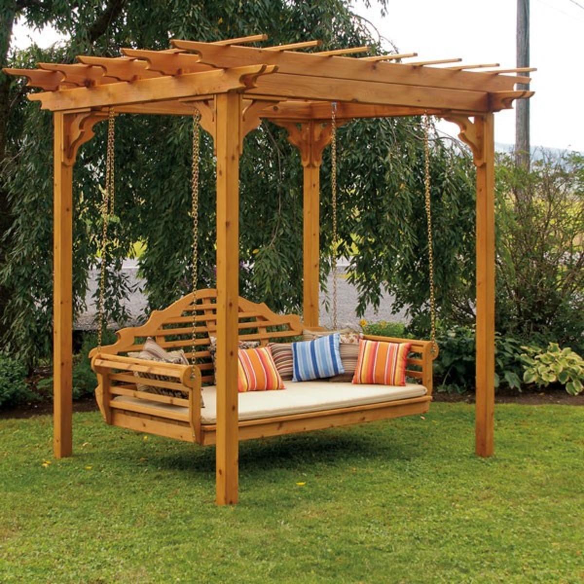 a functional cedar pergola with a swing