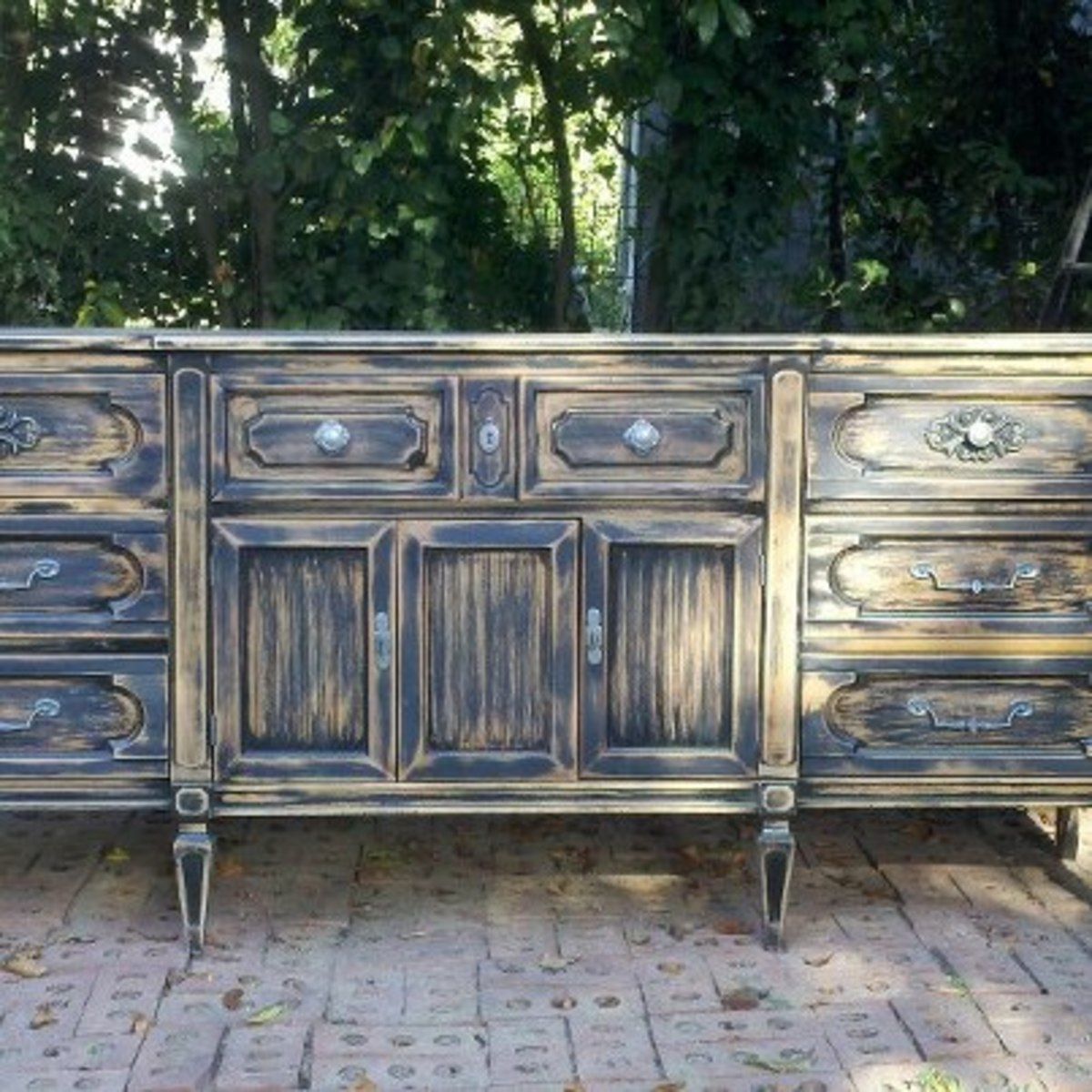 This Buffet was a circa 1970 piece. It had a blond finish. We sprayed it black then sanded it heavily to remove some 75% of the finish. The purchaser loved it. Our total investment in this piece was less tha $100