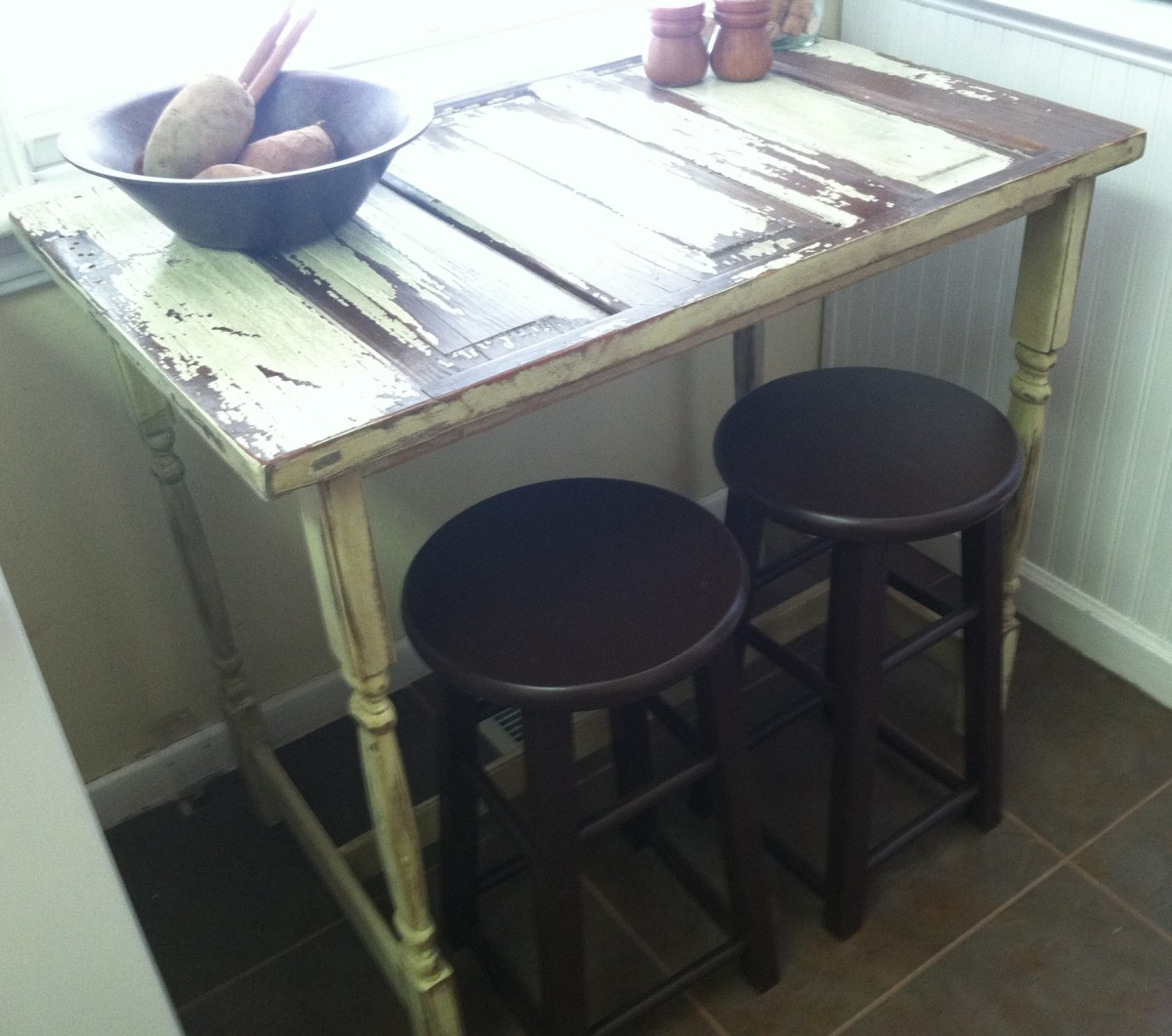 We built this bistro table from a section of old door. It was already distressed so we finished the legs and cross braces to match then added a coat of sealer to preserve to look.. Our total cost around $80