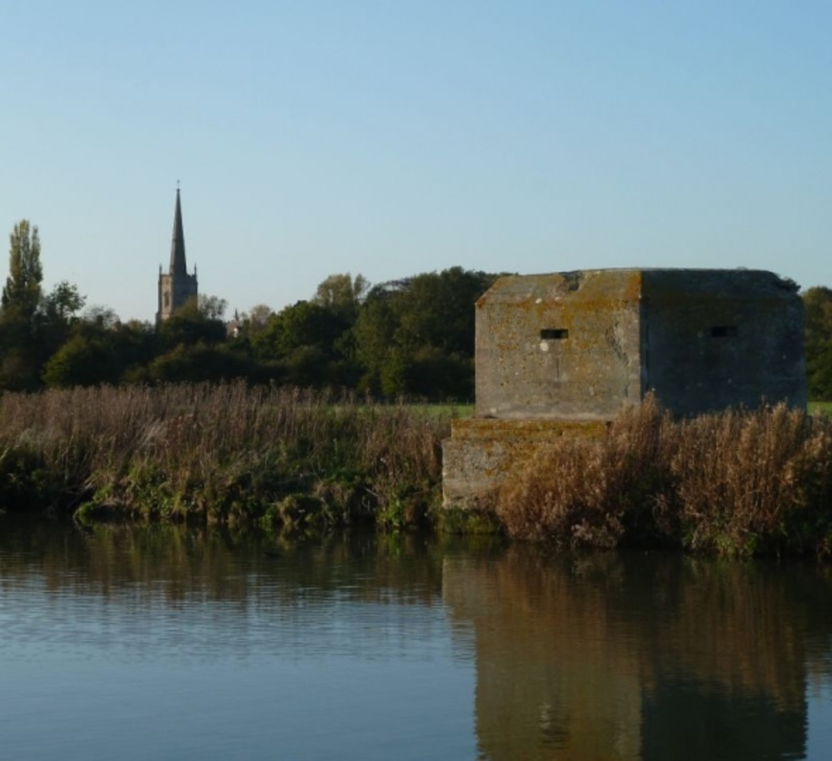 Pillbox at Lechlade view of  St Lawrence Church in distance