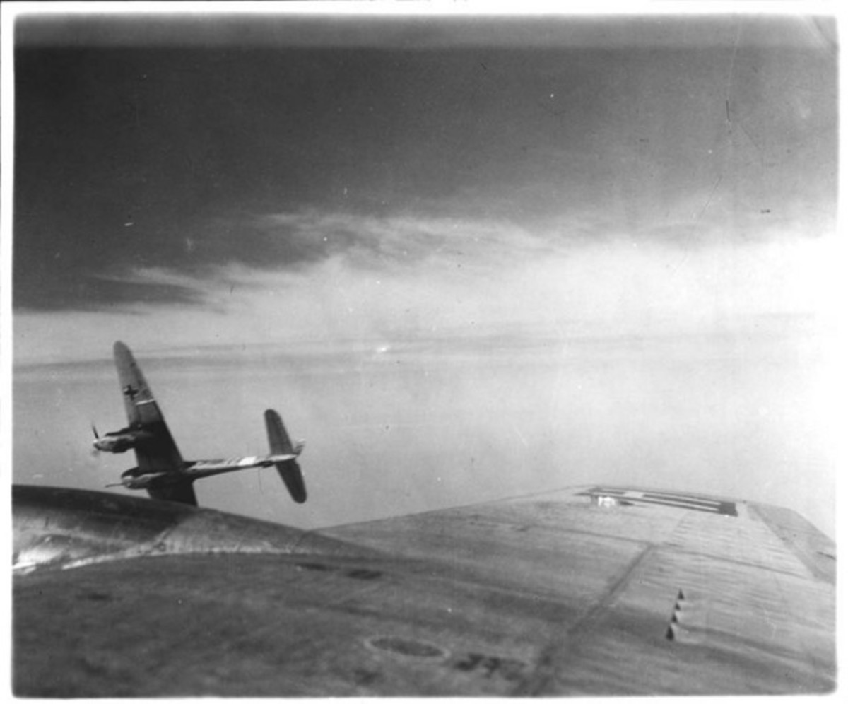 A 50mm cannon equipped Me-410 peels off after attacking a B-17 formation.