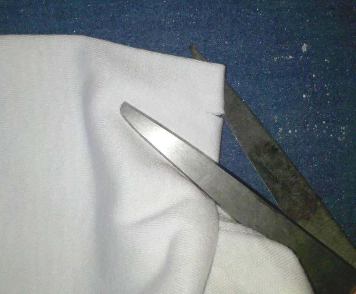 Cut small slits beside the center line of the t-shirt.