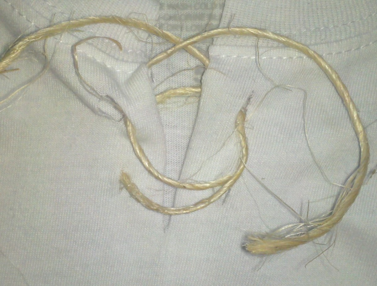 "Weave twine through the slits to ""fasten"" the neck opening."