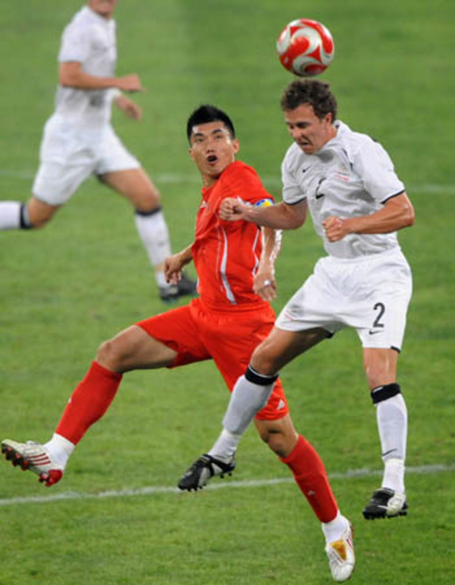 Aaron Scott of New Zealand (2) battles for the ball with China's  Zheng Zhi during a football match on Aug. 7, 2008 in the Summer Olympics. The match finished 1-1 in Shenyang, China.
