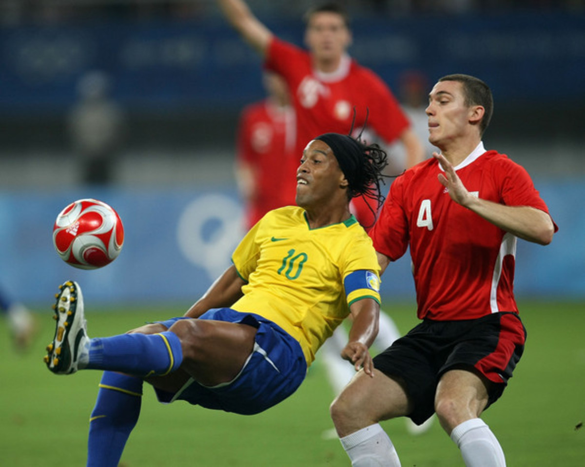 Brazil's Ronaldinho (10) and Belgium's Thomas Vermaelen in action during the teams' bronze medal match on Aug, 22. 2008. Brazil defeated Belgium twice, including a 3-0 result to win the bronze medal.