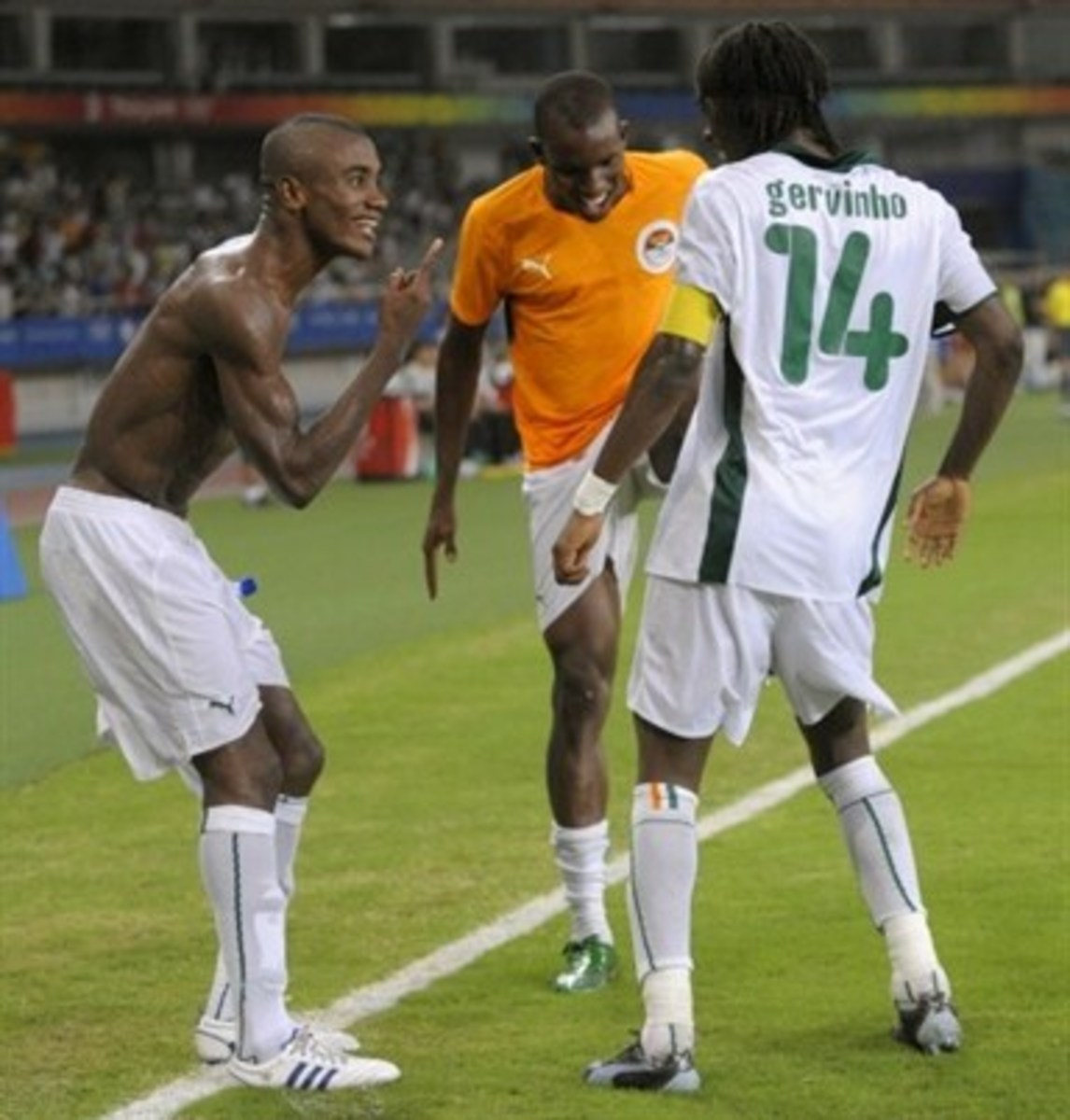 Solomon Kalou (L), Sekou Cisse (C) and Gervinho (R) celebrate for the Ivory Coast following a goal by Gervinho late in its match against Serbia in Shanghai on Aug. 10, 2008. The Ivory Coast won 4-2